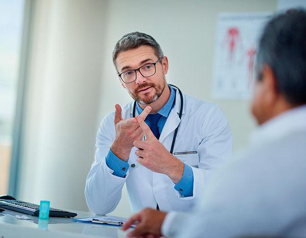 imagem Médico e paciente